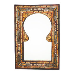 Moroccan Keyhole Arch Inlaid Mirror - This enchanting artisan-crafted mirror features the classic Moroccan keyhole arch shape. The sturdy wood frame is inlaid with hand-carved wood and bone with embossed metal overlays. Approximately 23.25 inches x 16.5 inches.