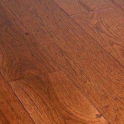 """Jasper - Jasper Hardwood - 6"""" Hickory Collection - [20.5 sq ft/box] - Buckskin / Hickory / Builders / 6"""" -      Beautiful and durable, the Jasper Hickory Collection offers both strip or plank hardwood flooring. Known as the hardest North American species available, this line of flooring is not only durable but is also precisely milled as it is US manufactured and finished. The 8 coats of Treffert brand aluminum oxide allow for a smooth finish of these Standard grade floors and is completed by microbeveled edges on all four sides. The tongue and groove locking system and nail down installation allow for ease of installation.        Its durability paired with its natural and unique black streaked characteristics make the Jasper Hickory Collection hard to resist. Combine that with a 25 year finish warranty and a lifetime structural warranty, your choice in Jasper Hardwood floors is a confident one."""