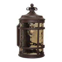 Exteriors - Exteriors Espana Traditional Outdoor Wall Sconce - Small X-19-4005Z - This Craftmade Espana Traditional Outdoor Wall Sconce is Small in scale but big on style. Notice the beautiful construction of the cast iron frame in a rich, rustic iron finish that perfectly complements the hammered champagne glass shade. It's stunning piece that will cast a warm and natural hue of light in most any outdoor space.