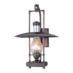 """Troy - Dakota Collection 18"""" High Outdoor Wall Light - The Dakota outdoor collection from Troy Lighting illuminates your exterior with refined rustic glamour. This wall light design builds on the hurricane lantern aesthetic adding sleek materials and graceful lines. Crafted from solid brass and presented in an English bronze finish. Clear seeded glass adds extra appeal. An attractive design for lighting your outdoor spaces. Solid brass construction. English bronze finish. Clear seeded glass. Takes one 60 watt candelabra bulb (not included). 18"""" high. 12"""" wide. Extends 6 1/4"""" from the wall. 9 1/2"""" from mounting point to top.  Solid brass construction.   English bronze finish.   Clear seeded glass.   Takes one 60 watt candelabra bulb (not included).   18"""" high.   12"""" wide.   Extends 6 1/4"""" from the wall.   9 1/2"""" from mounting point to top."""