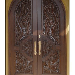 Custom Carved Entry Doors - Custom carved solid mahogany arched doors.