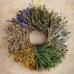 "Viva Terra - Segmented Herb Wreath with Hanger - Handcrafted by artisans at a family-ownedfarm, this all-natural wreathcombines fresh rosemary with driedsavory, dill, marjoram, sage and lavenderfor a long-lasting kitchen accent.All the herbs are grown withoutchemicals and are hand-harvestedto preserve their scent and shape. Grown in USA. WREATH 15""DIAM, HANGER 13""L"