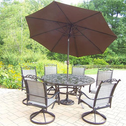 Oakland Living - 9-Pc Traditional Outdoor Dinning Set - Includes table, six swivel rockers, 9 ft. tilt crank umbrella with stand and metal hardware. Traditional lattice pattern and scroll. Hardened powder coat. Handcast. Fade, chip and crack resistant. Warranty: One year limited. Made from cast aluminum and sling. Black color. Minimal assembly required. Table: 60 in. Dia. x 29 in. H (70 lbs.). Swivel Chair: 24 in. W x 30.5 in. D x 40 in. H (16 lbs.)The Oakland cascade collection combines contemporary style and modern designs giving you a rich addition to any outdoor setting. We recommend that the products be covered to protect them when not in use. To preserve the beauty and finish of the metal products, we recommend applying an epoxy clear coat once a year. However, because of the nature of iron it will eventually rust when exposed to the elements.