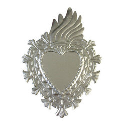 Mexican Artisans - Natural Tin Fiery Heart Mirror - For that corner of a room that needs a little love — nothing could be better than this little tin heart mirror. It's the perfect spot to check your lipstick as you run out the door, and it will give your room a touch of the exotic. Hand-crafted in Mexico, this mirror will reflect a sense of worldly style wherever you hang it.