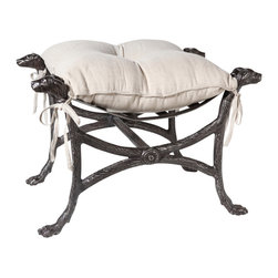 Studio A - Bow Wow Bench - Charming and useful, this little bench is also surprisingly stout and sturdy. The dog paw feet are complimented with the heads of four noble retrievers. Solid cast iron in a graphite finish. Poly-filled linen cushion.