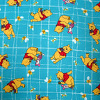 "SheetWorld - SheetWorld Fitted Oval Crib Sheet (Stokke Sleepi) - Pooh Blue Grid - Made in USA - This is a SheetWorld product made from Disney's Winnie The Pooh printed fabric. This 100% cotton ""flannel"" oval crib (stokke sleepi) sheet is made of the highest quality fabric that's ""double napped"". That means these sheets are the softest and most durable. Sheets are made with deep pockets and are elasticized around the entire edge which prevents it from slipping off the mattress, thereby keeping your baby safe. These sheets are so durable that they will last all through your baby's growing years. We're called sheetworld because we produce the highest grade sheets on the market today. Features the one and only Winnie The Pooh! Size: 26 x 47."