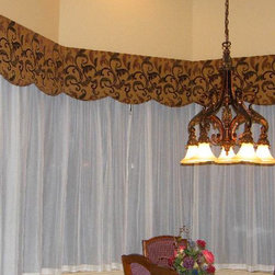 Bay Window with Valance-Bendable Curtain Rod - This is from our new line of bendable rods. It's highly bendable, multipurpose curtain track system that can be quickly customized to fit any wall shape or ceiling curvature. It comes in several gauges to support up to 50lbs per foot.  These rods can mount to your ceiling or your wall.
