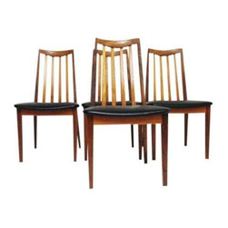Pre-owned G-plan  Mid-Century Modern Teak Chairs - Set of 4 - Mid-Century Modern chairs in teak by G-plan with black vinyl upholstery. Gems for your dining room! This set of four is in excellent vintage condition with minor, age appropriate, wear and tear.