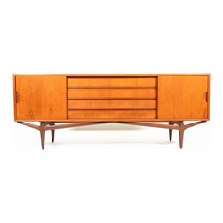 "Consigned Danish Modern V Leg Teak Credenza - This breathtaking Danish modern mid century teak credenza.  The case floats above a beautiful sculpted ""v"" base.  The perfect scale for any dining or living room, this piece will make a wonderful addition to your modern home.  Left and right doors slide open to reveal adjustable shelving.  Four long center drawers provide additional storage.  Recently refinished and in excellent condition."