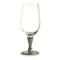 Anna Beverage Glass - A delicate but handsomely simple concentric-dot pattern ringing the foot of the Anna Beverage Glass emphasizes the craftsmanship of its unusual smooth pewter foot.  Crafted with elegant, pared-down lines from clear glass and authentic pewter, this glass is suitable for soft drinks and liquors of all kinds and brings an appealing touch of the old world to your entertaining space.