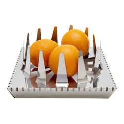 Filo Fruit Bowl - Handmade from one piece of stainless steel, the Filo Fruit Bowl is as impressive as it is intense. This unique shape is meant to provoke conversation. Your kitchen will never be the same.�Designed by Rubens Sim�es and The Adriano Brothers.�Handmade in Brazil.