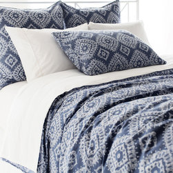 """Pine Cone Hill - PCH Ramala Indigo Duvet Cover - Modern style meets globally-inspired design on the PCH Ramala duvet cover. Embodying eclectic sophistication, this bedding's cream diamond pattern excites across an indigo background. Button closure; Machine wash; Enzyme washed; Insert not included; Available in twin, full/queen and king sizes; Due to the handcrafted nature, color variations may occur; Designed by Pine Cone Hill, an Annie Selke company Twin: 68""""W x 88""""H; Full/queen: 88""""W x 88""""H; King: 102""""W x 92""""H"""
