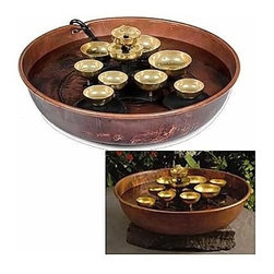Oriental Unlimted - Soothing Water Fountain w Floating Bells - Includes copper bowl and 10 Brass bells. Water Bell fountain adds the soothing sound of bells to any home or office. Swirling motion of floating bells creates peaceful chiming sound. No assembly required. 6.5 in. H x 16 in. D