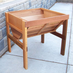 Wood Country - Wood Country Cedar Wood Vegetable Raised Planter Box - RVGB-UNSTAINED - Shop for Planters and Pottery from Hayneedle.com! Discover the benefits that come with raised gardening when you bring home the Wood Country Cedar Wood Vegetable Raised Planter Box. This wood bin stands 33 inches tall conveniently raising your garden off the ground. Benefits of raised bed gardening include improved soil conditions higher yields easy access an extended growing season and better pest control. Plus you can set up your raised garden bed just about anywhere and with less effort than a traditional garden because you won't have any digging to do. You won't even have to worry about soil conditions. For all these reasons a raised garden bed is ideal for backyards rooftop gardens schools and community centers. About Wood CountryFine handcrafted outdoor furnishings are what Wood Country is all about. They manufacture a complete line of outdoor furniture and accessories made of clear kiln-dried Western Red Cedar. Each piece is hand-crafted and finished with a high quality penetrating oil weather stain. Wood Country is about offering their customers choices allowing them to create their own custom environment perfectly suited to enjoy their leisure time. Customers can choose the styles they like based on family need budget or just personal tastes. Wood Country uses the best materials hardware fabric and finishes they can find. Quality materials combined with Wood Country's talent means you're getting some of the best outdoor furniture available in today's market.