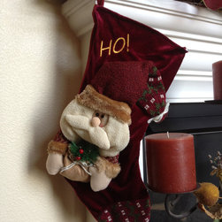 None - HO! Santa Christmas Stocking - Decorate your Christmas tree by giving the entire family their own embroidered Santa Christmas stocking. This attractive Christmas stocking makes a great way to welcome Santa to your home each and every Christmas.