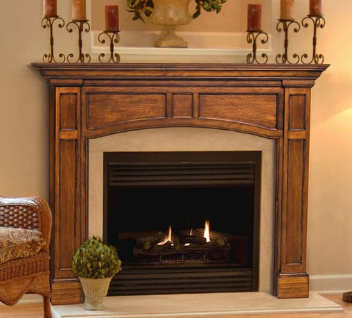 Pearl Mantels - Pearl Mantels Vance Wood Fireplace Mantel Surround - 160-56 - Shop for Mantels and Trim from Hayneedle.com! The Pearl Mantels Vance Wood Fireplace Mantel Surround features a transitional design that lends itself to any decor from traditional to modern. Plinth columns with recessed carvings a graceful arched front and a clean-lined pediment will create a flattering display around any fireplace. Choose the 48- or 56-inch internal-width option to fit your fireplace. This fireplace surround is crafted from solid wood which offers proven durability and quality. Available in a Medium Oak finish or leave it unfinished. Choose the unfinished option to customize the appearance of your fireplace with your choice of finishing varnish or paint. Mantel Surround Dimensions 48-in. 56 -in. A. Shelf length 70.5 in. 78.5 in. B. Interior width 48 in. 56 in. C. Interior height 42 in. 42 in. D. Width to outside leg at base 64.5 in. 72.5 in. E. Overall height 61.5 in. 61.5 in. F. Shelf depth 8 in. 8 in. G. Leg Depth 4.75 in. 4.75 in. About the Pearl InlayPearl Mantels now include a discrete authentic pearl-style inlay on each of their pieces. Your Pearl Mantel may or may not include this feature depending on purchase date. Please contact our Customer Care Center with any questions. About Pearl Mantels Inc. Pearl Mantels Inc. believes in business based on honest value quality products and personal service - even contacting clients directly to evaluate their needs and develop leading-edge solutions. Pearl also believes mantels are the emotional core of rooms representing heritage and tradition and displaying precious heirlooms. Each Pearl mantel boasts exclusive detail and classic design all at an affordable price. Plus a variety of finish options ensures Pearl Mantels Inc. indeed has a mantel for every hearth. Wood and MDF are combustible. Please review heat clearance specifications before installation. Consult your local building codes and manufacturer information regardi