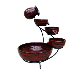 Smart Solar - Lava Ceramic Solar Cascade - Lava Red finish - Ceramic solar powered 4 tier cascading fountain with wrapped line design in red. Creates a relaxing atmosphere on your patio, deck, balcony or in your garden. Recycles water from the main bowl reservoir. Operates in direct sunlight. Powered by a separate solar panel with a 10 ft cable. Low voltage pump with filter. No wiring, simply install and enjoy. No operating costs.