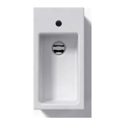 WS Bath Collections - Ceramica Above The Counter Bathroom or Wall M - Over-counter (Vessel) Installation. Without Overflow. Made to Highest Industry Standards. Made in Italy. Product Material: White Ceramic. Finish/Color: White. Faucet Holes: 1. Dimensions: 5.1 in. W x 19.7 in. L x 9.8 in. H