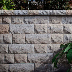 BelAir™ Wall - BelAir™ Wall offers the ideal solution for residential and light commercial retaining and freestanding wall construction where aesthetics are a key consideration. The attractive multi-piece design and blended colors offer an alternative look to traditional retaining wall blocks. The system can be used in applications ranging from curves to corners, terraces to raised patios, or steps to columns.