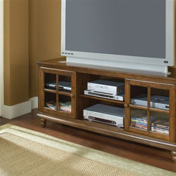 Hillsdale - Grand Bay 61 in. Entertainment Console - Warm Brown Finish. Two glass front cabinets with adjustable shelves. 61 in. W x 18.5 in. D x 27 in. HTransitionally designed to blend easily into both contemporary and traditional d���cor, the Grand Bay entertainment console adds versatility across many decor styles. It is constructed of solid wood with veneer and the back features knockouts for easy cable management. The console offers two glass front cabinets with adjustable shelves for storing your electronics, game systems, DVDs and CDs.
