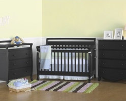 """DaVinci - Emily Three Piece Convertible Crib Nursery Set with Toddler Rail in Ebony Black - The Emily Convertible crib set is perfect for your child. Suitable for newborns, toddlers, and youth, the Emily Convertible Crib can change from a crib to a toddler bed to a daybed to a full-sized bed. The optional Wooden Bed Rails is a very simple and cost effective solution to transition your child's crib into a Full Size Bed. The mattress spring system adjusts to four different levels, allowing the crib to last through your infant's growth. FurnitureFeatures: -Emily Crib, Emily Changer & Emily Four Drawer Dresser included in set. -The Emily Convertible crib has a 4-level mattress spring system and includes the Toddler Bed conversion kit (Full size headboard and footboard). -Changing Tables includes 1"""" Pad and safety belt. -Optional Wooden Bed Rails for Full Size Bed conversion. -Meets and exceeds all US safety standards. -Actual color may vary slightly from shown. -Constructed from New Zealand Radiata Pine Wood. -Ready to assemble. -Linens not included. This is a NON-Drop Side crib About New Zealand Radiata Pine Wood: Radiata Pine, better known as 'New Zealand Pine' is a softwood tree that contains many properties that make it very suitable for furniture and furniture making. It has a density equal to that of hardwoods like poplar, mahogany and oak. Its uniform density ensures a smooth and consistent texture and confers its excellent machining, painting and staining properties; there is almost no variation in color between pieces. DaVinci's pine wood originates from forests maintained by managers that enforce environmental responsibility and the conservation of forest wildlife. ***Please note that these products cannot be shipped to Alaska, Hawaii, or Puerto Rico. We apologize for the inconvenience - feel free to call us regarding alternatives! This Crib is approved for use in the United States."""