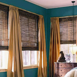 Woven Woods - Here we have a beautiful woven wood design complimented by drapes. The woven woods come in many darkening percentages, different wood patterns, and they can also be used as a roman and/or roller shade. These woven woods and drapes can booth be found in: www.shadesonlinediy.com
