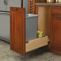 Rev-A-Shelf Single Rev-A-Motion Pull Out 50 qt. Trash Can - Clean up the kitchen with the Rev-A-Shelf Single Rev-A-Motion Pull-Out 50-Quart Trash Can and its patent-pending Rev-A-Motion Soft Open-Soft Close slide system. The innovative gas spring-assisted Soft-Open allows the unit to open smoothly and the Soft-Close shuts softly even under the heaviest of loads. The unique design allows installation into 1.5-inch 1.625-inch and 1.75-inch face frame sizes as well as frameless constructions. Storing up to 50 quarts or 12.5 gallons of waste the waste unit has a metallic silver exterior and a dovetail constructed frame for a clean look. A removable wood bin stores bags in the rear compartment. Built-in door-mount brackets and five screws are included for easy installation. Dimensions: 21.375L x 11.25W x 23.1875H inches.About Rev-A-ShelfOriginally a division of Ajax Hardware Rev-A-Shelf was established in 1978 as a family-owned manufacturer of a variety of helpful home products. Rev-A-Shelf offers Lazy Susans kitchen drawer organizers cabinet and pantry pull-outs and functional waste containers. All products consist of polymer wire wood and stainless steel components which will seamlessly complement kitchen appliances and accessories. Rev-A-Shelf aims to revolutionize the way kitchens are organized across the country.