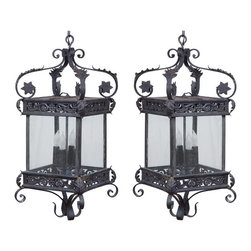 Pair of Continental Iron Lanterns - This pair would set the mood for an intimate dining room. They would be a stunning alternative to a typical crystal chandelier.