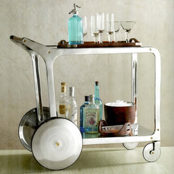 Circa Bar Cart - A swanky service with more than a splash of style, our bar cart is made entirely of recycled cast and sheet aluminum with the exception of its handsome wood handle and brass accents.  Two tiers provid space to pour and store libations, while clean metal disk wheels allow for a movable party.