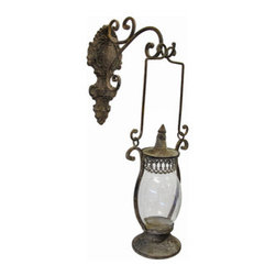 Antique Finish Metal Lantern and Decorative Wall Mounted Hanger - This wall mounted lantern adds an antique accent to your home, porch, or patio. The decorative hanger measures 11 inches tall, 4 3/4 inches wide, 10 3/4 inches deep and mounts to the wall with a single nail or screw. The lantern is 12 inches tall, 7 1/4 inches wide, 4 1/2 inches deep and has a 6 1/2 inch drop from the handle. The glass globe measures 6 inches tall and approximately 4 1/4 inches in diameter. This piece has a wonderful weathered, antique finish, and looks great with a flickering LED candle in it.