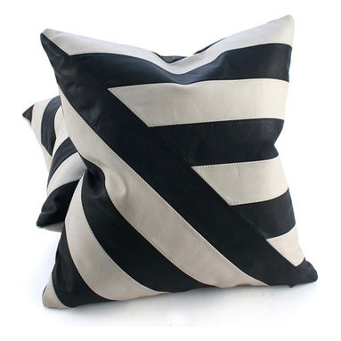 Pfeifer Studio - Black and White Leather Pillow - The simplicity of black and white leather brings out the graphic geometric patterns in these statement-making cushions. Choose from two styles; Diagonal Lines or Four Quadrants. The pillows have a black leather back and are fitted with a medium-fill feather and down inner. Our pillows are each individually handmade-to-order using natural materials, each is considered unique and one-of-a-kind.