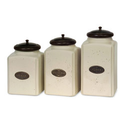 iMax - Ivory Canisters, Set of 3 - An aged cream finish gives this canister set a classic look. Each canister has a brown lid and features its own content label. For storing your sugar, cookies and flour, this set of ceramic canisters is perfect. Food safe.