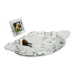 "Godinger Silver - Crystal Vanity Set With Tray - Get this vanity set as a thoughtful and lovely gift that your mother will cherish for years to come. It will have a place of honor on her chest or dresser. Wherever you display it, its fine crystal reflection will surely enhance any part of your home. Makes a great gift for practically anyone! * Tray 18"" long, * Frame: 4"" Square * Brush: 6"" long * Ring Holder: 3.5"" Diameter."