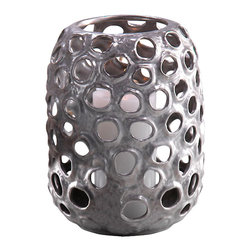 """Cage Pot Ceramic Lantern, 7.25"""" X 9.25"""" - An intriguing accessory that lends a great texture to any living room or master bedroom, the Cage Pot Ceramic Lantern comes in three sizes, ready to house a pillar candle. With an aged silver finish and circular cut outs that let the candle light shine through, this is a gorgeous vessel to group with all three sizes as a coffee table centerpiece for a romantic evening. Set the mood for relaxation and good company with the soft illumination of candlelight from a unique vessel that is ideal for subtly changing the look and feel of a space."""