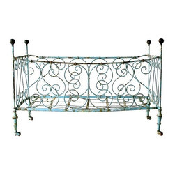 Pre-owned French Antique Baby Crib C. 1800's - Bon Nuit!    This rare French antique iron crib will add a touch of whimsy to your home. Folds flat. Great piece with loads of character - very Anthropologie. Not suitable for use as a crib today, but would be a charming filled with toys. The worn blue painted finish is amazing.