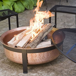 Woodstream (was Opus Inc) - CobraCo Hand Hammered Copper Fire Pit Multicolor - SH101 - Shop for Fire Pits and Fireplaces from Hayneedle.com! The 100% copper tub of the CobraCo Hand Hammered Copper Fire Pit is built the old-fashioned way and you'll be able to tell the difference. With shine and durability that you just can't get from low-quality materials and cheap factory-line manufacturing this extra-deep tub will hold a large fire and age beautifully with you and your home. It sits in an all-metal frame with contemporary lines and comes complete with a full-coverage dome spark guard and protective vinyl cover with elastic stretch band.About Woodstream and CobraCoA privately held company with a long-standing positive reputation Woodstream is a global manufacturer and marketer of quality products from pets and wildlife control and home and garden products to bird feeders and garden decor. They have a 150-year history of excellence growth and innovation and have built a strong presence in key markets through organic growth and strategic acquisitions.Most recently Woodstream acquired CobraCo which offers an extensive line of planters baskets flower boxes and accessories. The growth of Woodstream is thanks to their customer-driven approach to product development a dedicated design organization that focuses on innovation quality and safety as well as a commitment to an industry-leading level of service.