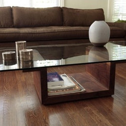 """ARTLESS - SQG Coffee Table Set - A glass top variation of the SQ Tables and a continuation on our use of 2"""" solid wood. The base's inverted pedestal form allows for the display of objects and books, while the glass top acts as a lid. The base's heaviness and solidity reminds us of Minimalism's sculptural forms while the glass extends out not only protecting the base but expanding the base's footprint. Features: -SQG collection. -Hand rubbed oil solid black walnut finish. -0.38"""" Tempered glass. -Made in USA. -Overall dimensions: 12.5"""" H x 48"""" W x 30"""" D."""