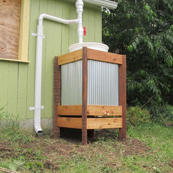RainCRATE - The RainCRATE provides a unique enclosure for a 55gal rain barrel for the collection, storage, and distribution of rain water for your garden or landscape. Available as pictured in reclaimed wood / cedar or treated lumber. Price does not include diverter or installation.