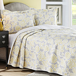 Laura Ashley Home - Yellow Joy Quilt Set - Modern and creative style combines with traditional charm in this beautiful bed set. A unique color palette will give your room a new look, and its comfy cotton will inspire happy late starts.   Includes quilt and two shams (twin size includes one sham) 100% cotton Machine wash Imported