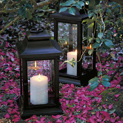 "Frontgate - Kingsley Outdoor Lantern - Frontgate exclusive. Ideal accent lighting for a side table or on the ground next to a furniture collection. Powdercoating protects against the elements. Decorative circular loop handle at top enables easy movement. 20"" Lantern holds a 4"" dia. x 6""H candle (sold separately). Clean lines and clear, beveled glass make a stately showcase for candlelight in any outdoor space. In two large sizes, this durable, cast-aluminum lantern features protective powdercoating and a 3"" ring handle for transport. . . . . . 23"" Lantern holds a 4"" dia. x 9""H candle (sold separately). Can also be used with a battery-operated candle (sold separately). Open door to insert candles, light and clean. Venting in top allows heat to escape. Drain hole whisks away rain water. Attached handle; no assembly required. For outdoor or indoor use. Wipe clean with a damp cloth."