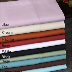 None - Classic Percale Oversize Sheet Set Twin or Full - This 250-thread percale sheet set comes with a flat sheet, a fitted sheet, and two pillow cases. The sheets come in a rainbow of colors and are machine washable. The pillowcases have a 4' hem. The sheets are 55 percent cotton and 45 percent polyester.