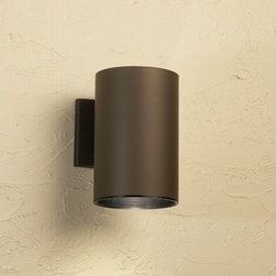 """Kichler - 9"""" Cans and Bullets Outdoor Wall Lantern in Architectural Bronze - This handsomely modern wall mount is the perfect light for porches, pathways, and steps. While remaining unobtrusive and understated, it adds a beautiful contemporary feel to any outdoor area. Features: -One light outdoor wall lantern -Cans and Bullets collection -Architectural bronze finish -Aluminum body -Maximum wattage: 150W -Voltage: 120V -Medium base to accommodate 1 regular incandescent bulb (not included) -Dimensions: 9"""" H x 6"""" W -Suitable for wet locations About Kichler: Kichler Lighting is a four-time winner of the Arts Award as Lighting Manufacturer of the Year. The highest accolade our lighting industry can give. Today they are the leading decorative lighting fixture company in the world. Founded in 1938, Kichler remains a privately held, family owned and run business staffed by people who understand decorative home lighting fixtures and who care about their customers. Kichler has built their reputation on original, design-oriented, high quality lighting products at competitive prices, backed by the finest customer service in the industry. Helping to make your house a home is their job and our number one priority. They do this by providing their customers with the widest assortment of home lighting fixtures and home decor accessories in the industry. The Kichler family of brands offers lighting for every room in your home, designed to fit every pocketbook, offering choices to complement your lifestyle and tastes."""