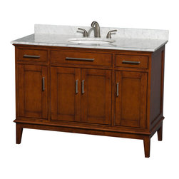 Wyndham Collection - Eco-Friendly Transitional Bathroom Vanity - Includes white Carrera marble countertop with backsplash and undermount oval sink. Faucet not included. Two functional drawers. Four functional doors. 8 in. widespread three hole faucet mount. 12 stage wood preparation, sanding, painting and hand-finishing process. Highly water-resistant low V.O.C. sealed finish. Practical floor-standing design. Deep doweled drawers. Fully-extending under-mount soft-close drawer slides. Concealed soft-close door hinges. Single faucet hole mount. Plenty of storage and counter space. Metal exterior hardware with brushed chrome finish. Engineered to prevent warping and last a lifetime. Made from zero emissions solid birch hardwood. Light chestnut finish. Vanity: 47 in. W x 21.5 in. D x 34.25 in. H. Vanity with Countertop: 48 in. W x 22 in. D x 35 in. H. Countertop: 48 in. W x 22 in. D x 0.75 in. H. Backsplash: 48 in. W x 0.75 in. D x 3 in. H. Warranty. Care Instructions. Counter Handling Instructions. Installation InstructionsBring a feeling of texture and depth to your bath with the gorgeous Hatton vanity series. A contemporary classic for the most discerning of customers. The Wyndham Collection is an entirely unique and innovative bath line. Sure to inspire imitators, the original Wyndham Collection sets new standards for design and construction.