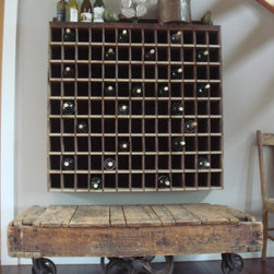 Mountain Primitive Modern - Vintage wood mail sorter(complete with name slots) converted to large wine rack, authentic antique cart below
