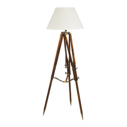 "Inviting Home - Tripod Floor Lamp (white shade) - Tripod lamp 24"" x 24"" x 50-5/8""H Hand crafted tripod lamp features wooden tripod with saddler's leather straps cream fabric shade and adjustable height. The mud and sandstone walls hid the multistory palace of Imam Yahya built in the 1930s. From one of the terraces where we were invited to dine in the evening we could look down some 1000 feet into the valley and the lights of the village. The floor was covered with bright carpets pots with plants were everywhere and the light came from candles set on tripods. Over chicken and lamb with lentils followed by cake and cardamom tea the Imam explained that the tripods were left by a British surveying expedition in the twenties mapping the deserts and hills of Yemen. We were impressed by the fact that the metal and wood combined with saddler�s leather straps still looked fresh and new obviously a combination of quality and form follows function."
