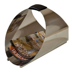 Conduit Magazine Caddy - Stainless Steel - A polished curve reflects the light in a composed, sleek form with the Conduit Magazine Caddy, an ellipse-shaped basket of stainless steel with a leather-wrapped carrying handle at its narrowest point. Ideal as a basket for light reading, it's also highly decorative and can be repurposed to hold firewood by a transitional hearth. Either way, it provides a visual statement as well as handy organization.