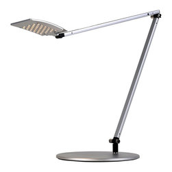 "Koncept - Koncept Gen 3 Mosso Warm Light LED Desk Lamp Silver - The Mosso LED desk light features a flat wide head packed with 42 energy efficient LEDs. It produces 40% more light than Gen 2 models and features improved design and adjustability. The detachable head not only swivels up and down but also twirls a full 360 degrees to precisely illuminate the task at hand. Slide your finger along the touchstrip to dim gradually or touch anywhere on the strip to jump directly to any brightness including off. The energy efficient LEDs produce a warm light that will last for up to 50000 hours. Five year manufacturer's warranty. This energy saving light earns LEED credits. Aluminum construction. Silver finish. One touch dimming and on/off. 9' black power cord. Includes 42 LEDs with 10.5 watts total energy consumption. 3200-3700K color temperature warm light; CRI 85. LED lifespan up to 50000 hours. Adjustable positions; maximum extension is 39"" high.  Aluminum construction.   Silver finish.   One touch dimming and on/off.   Includes 42 LEDs with 10.5 watts total energy consumption.  3200-3700K color temperature warm light; CRI 85.   LED lifespan up to 50000 hours.   Earns LEED credits.  18"" adjustable column.  16.5"" adjustable arm plus head measures 4 1/2"" x 3 3/4"".  9"" diameter weighted base.  9' black power cord.   5 year manufacturer's limited warranty."
