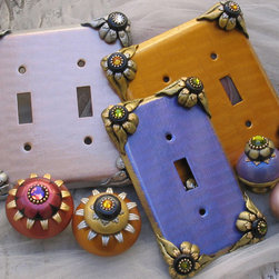 Susan Goldstick, Inc. - Painted metal light switch covers - Bloomer switch covers have matching knobs and pulls. Color motifs are purple and sage green, blush and silver, safflower yellow and pale yellow and adorned with Swarovski crystals.  Knobs are pulls are available in multiple styles.