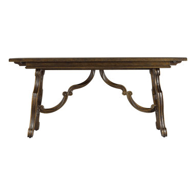 Stanley Furniture - Rustica Dining Room Harvest Table - Sorrel Finish - Our Harvest Table provides graceful function in any dining room. With its breadboard leaf inserts on either end, the Table easily accommodates six people. Meanwhile, the intricate C-scroll and volute carving on the base is a nod to the collection's Italian inspiration. Coupled with a plank top, the Harvest Table is a relaxed, yet sophisticated, take on a classic. Made to order in America.