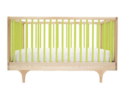 """Kalon Studios - Kalon Studios Caravan Crib Green - Kalon Studios designs nursery furniture with a focus on contemporary form, innovative style and sustainability. Inspired by a storybook circus wagon, the Caravan crib offers playful and modern elements. This minimalist baby furnishing features green slatted sides, two adjustable mattress heights and the option to convert to a platform toddler bed. Made in the USA from FSC-certified maple and low VOC, HAPs-free paint. Due to handmade and natural quality, slight color and grain variation may be present. 54.5""""W x 30""""D x 34""""H. Fits standard crib mattress (not included). Conforms to ASTM, CPSC and Health Canada regulations. Glue contains zero formaldehyde and exceeds European E1 and California emission standards by 3 times. Green guard certified."""